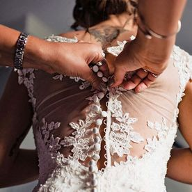 A wedding dress being worked on