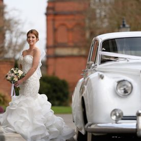 A bride near a car
